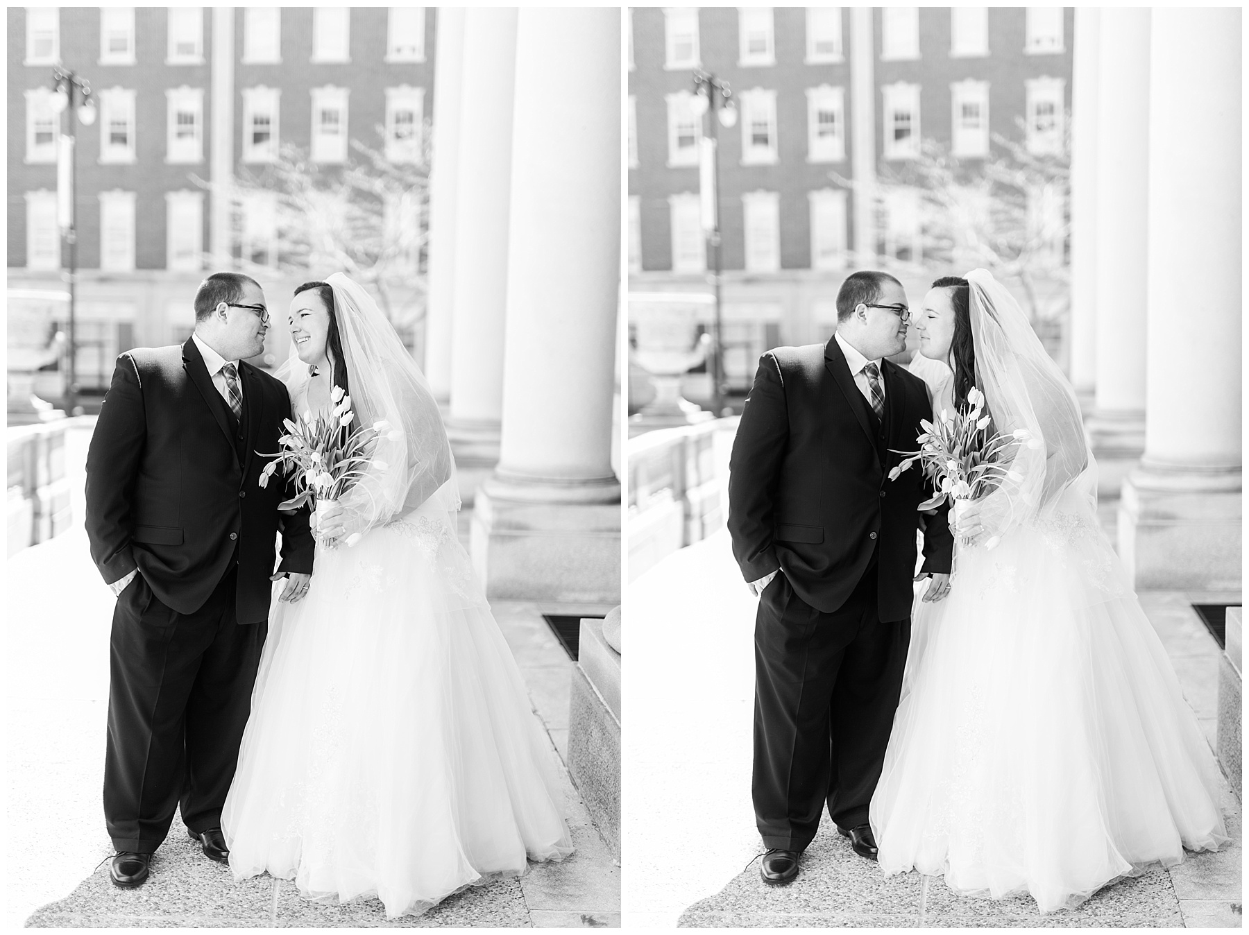 plus size couple in wedding attire taking wedding photos in downtown portland maine at city hall kissing holding tulips