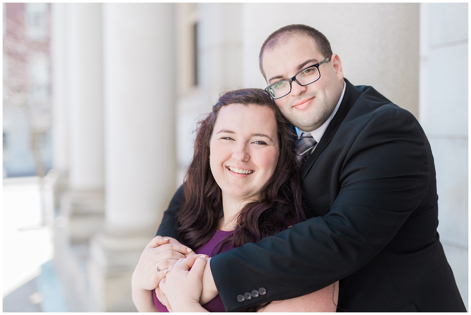 plus size couple in wedding attire taking wedding photos in downtown portland maine at city hall doing engagement photos
